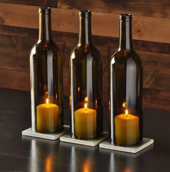 Repurpose your wine bottles and create wonderful candle lit grouping to add a warm twinkle to your rooms
