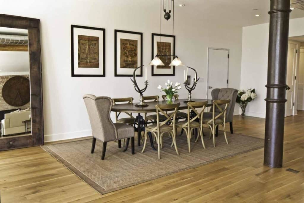 Add an area rug under kitchen tables or by your family room furniture grouping; looks wonderful and keeps your toes toasty