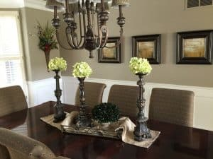 Reuse items in your home. Create a beautiful centerpiece using a tray or scar for a layered look.