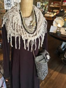 We also carry apparel and accessories at A Village Gift Shop.