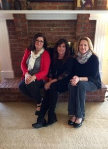 Diane Agricola with students in a client's home.
