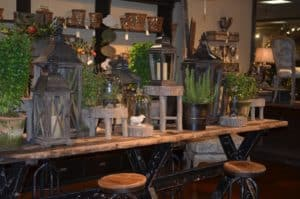 Check out our lanterns and greens at A Village Gift Shop. The staff is always able and willing to help create a wonderful display for your home.