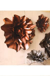 These large metal flowers are perfect for hanging on the wall or even using as a centerpiece on the dining room table.