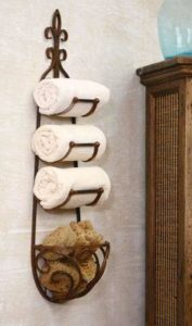 Wine racks are the perfect item to hang in a space-challenged bathroom to hold your towels and extra sponges.